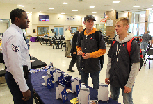 student talk to Air Force Sgt