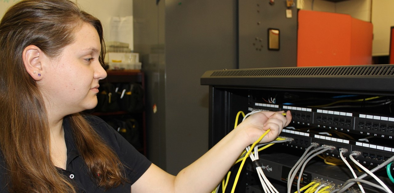 Student Working on Router