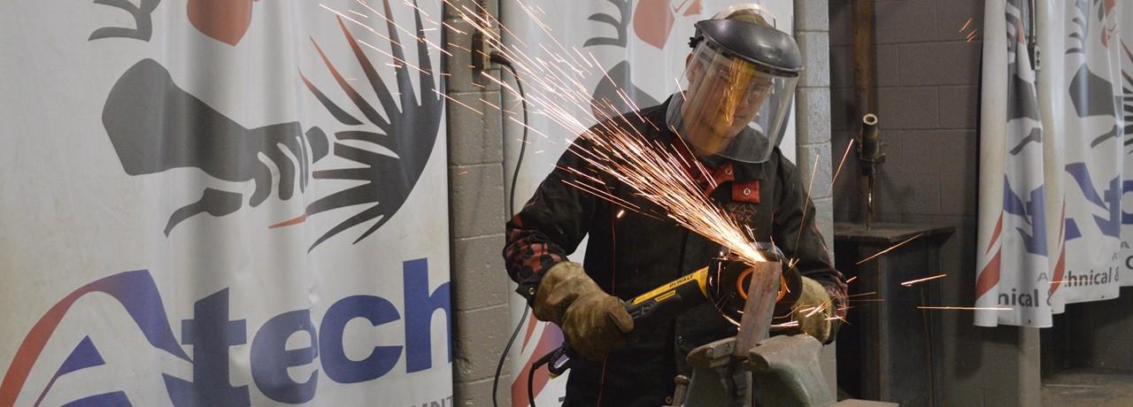 Welding Student Grinding Metal